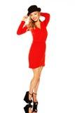 Blondine mit den langen schlanken Fahrwerkbeinen im roten Kleid Lizenzfreie Stockbilder