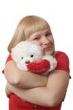 Blondine mit einem Plüschspielzeug Lizenzfreie Stockfotos