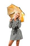 Blondine mit einem Regenschirm Stockfoto