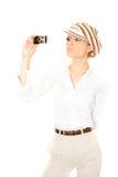 Blondine mit einer Kamera Stockbild