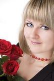 Blondine mit einer Rose Lizenzfreies Stockbild