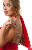 Blondine mit Handschellen Stockfotografie