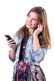 Blondine mit ihrem Handy Stockfoto