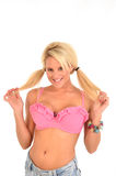 Blondine mit Schweinhecks Stockbild