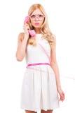 Blondine mit Telefon Stockfoto