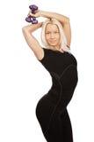 Blondine tut Übung Lizenzfreie Stockbilder