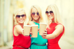 Blonds holding takeaway coffee cups in the city Royalty Free Stock Image