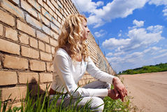 Blondy beautiful girl. Blondy between wall and road Stock Images