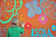 Blondy chłopiec przy ścianą Obrazy Royalty Free