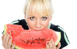 Blondy chwyta water-melon obraz royalty free