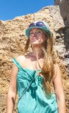 Blondy girl with sunglasses and blue hat on the beach. Tenerife Royalty Free Stock Images