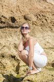 Blondy girl in white with sunglasses on the beach. Tenerife Royalty Free Stock Images