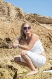 Blondy girl in white with sunglasses on the beach. Tenerife Stock Photography