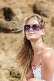 Blondy girl in white with sunglasses on the beach. Tenerife Stock Images