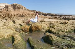 Blondy girl in white with sunglasses on the beach. Tenerife. Canarian Islands Stock Photo