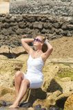 Blondy girl in white with sunglasses on the beach. Tenerife Stock Photos