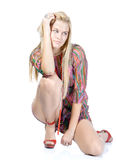 blondy on high red heels sitting on floor Royalty Free Stock Photo