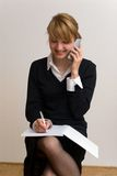 Blondy on the phone Stock Photography