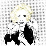 Blondy woman in furs. A woman explaining something. Royalty Free Stock Photo