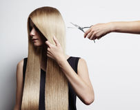 Blondy woman have a haircut. Blondy woman with a long hair have a haircut Royalty Free Stock Photography
