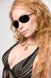 Blondy woman in sun-glasses. Blondy woman with long hair and yellow accessories in black sun-glasses Stock Photo