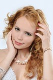 Blondy woman touches her face and hair stock photos