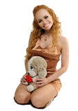 Blondy woman with a toy. Friendly looking blondy woman with a toy on knee Stock Photo