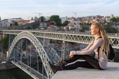 Blondy woman on the viewing platform opposite the Dom Luis I bridge, Douro river, Porto Stock Image