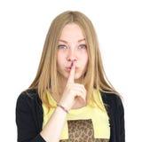 Blondynka naciska palec jej wargi Zdjęcia Royalty Free
