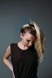 Blondynka patrzeje w dół z ponytail Obrazy Royalty Free