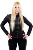 Blondynka z jej rękami na biodrach Zdjęcie Royalty Free