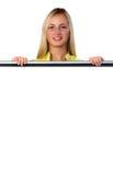 Blondyny za biały plakatem Fotografia Royalty Free