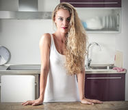 Blone girl in the kitchen Stock Photos