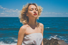 Blone at the sea. Portrait of a beautiful blonde young lady at the sea Stock Images