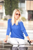 Blonf Woman On Bycicle Stock Photos