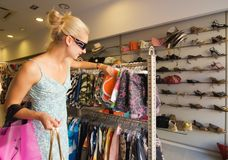 Blong girl buying clothes Stock Photo