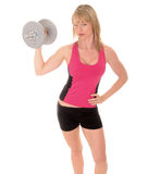 Blong girl excersizing with weights Stock Images