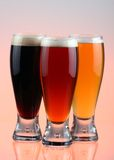 Blong, red, brunette. Close-up of beer glass royalty free stock image