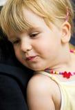 blont gulligt flickahår Arkivbild