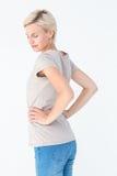 Blont kvinnalidande från tillbaka smärtar Arkivfoton