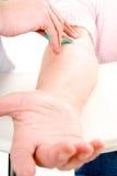 Blood analysis. Senior woman arm getting blood analysis royalty free stock photos