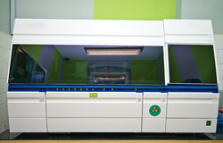 Blood analysis machine in laboratory Royalty Free Stock Images