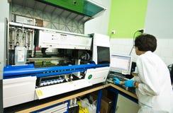 Blood analysis machine in laboratory Stock Photo