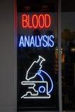 Blood analysis neon sign Stock Image
