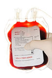 Blood bag. Doctor's hand holding a bag of donor blood stock photography