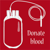 Blood bag on red background with text donate blood Royalty Free Stock Image