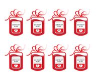 Blood bags positive and negative. Eight blood donation bags with tube shaped as a gift bow and the slogan: Give the Gift of Live. Four main blood groups of A, B Stock Photo