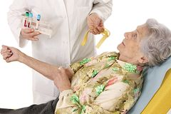 Blood colletion elderly woman Royalty Free Stock Images