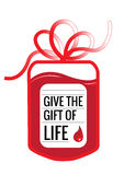 Blood donation. A blood donation bag with tube shaped as a gift bow and the slogan: Give the Gift of Live. EPS10 vector format Stock Photos