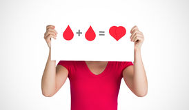 A blood donation sign being held up Stock Photo